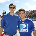 NFL star Eli Manning and Taylor Lautner share a moment at the Fourth Annual DIRECTV Celebrity Beach Bowl at DIRECTV Celebrity Beach Bowl Stadium South Beach on in Miami Beach, Fla., on February 6, 2010