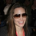 Angelina Jolie smiles as she leaves Super Bowl XLIV on February 7, 2010 in Miami, Florida