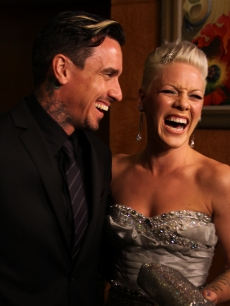 Carey Hart and Pink share a laugh backstage at the Grammys, Los Angeles, January 31, 2010