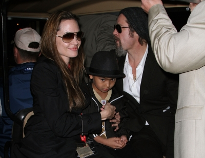 Angelina Jolie, son Maddox and Brad Pitt make it a family affair at Super Bowl XLIV at the Sun Life Stadium in Miami Gardens, Fla., on February 7, 2010