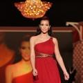 Kim Kardashian models a Marchesa design from The Heart Truth Red Dress collection on Feburary 11, 2010 during Fashion Week in New York