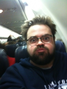 Kevin Smith makes an unhappy face on a Southwest flight on February 13, 2010