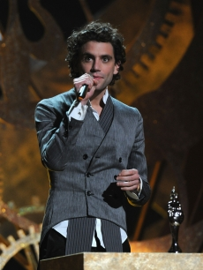 Pop singer Mika stands at the podium at the Brit Awards, London, February 16, 2010