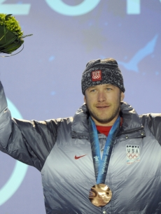 Bode Miller celebrates his bronze medal after the Men&#8217;s Alpine skiing downhill event of the Vancouver 2010 Winter Olympics