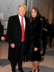 Donald Trump and Melania Trump attend Mercedes-Benz Fashion Week at Bryant Park on February 17, 2010 in New York City.
