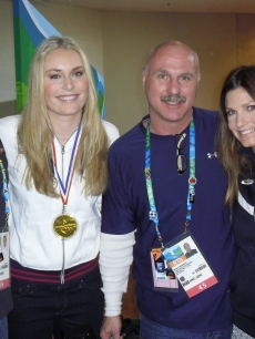 Access crewmembers Buddy S. and Wally H. pose with gold medalist Lindsey Vonn and silver medalist Julia Mancuso at the 2010 Winter Olympics held in Vancouver, Canada, February 2010