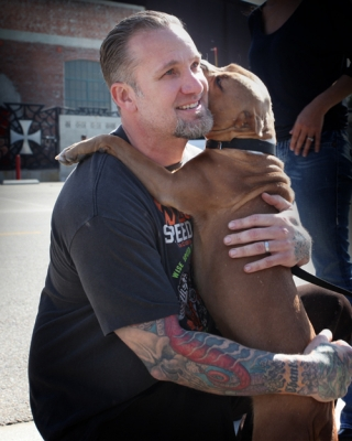 Jesse James smiles with his returned dog, Cinnabun, in Long Beach, Calif., on February 17, 2010