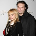 Brittany Murphy and husband Simon Monjack get close backstage at the Max Azaria show at Bryant Park during Mercedes-Benz Fashion Week in NYC on February 4, 2008