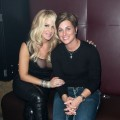 Kim Zolciak and DJ Tracy Young pose at Splash Bar in New York City on December 10, 2009