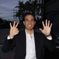 Apolo Anton Ohno raises eight fingers to represent his eight Olympic medals outside the Access set in March 2010