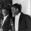 Sidney Poitier poses with his Oscar for Best Actor backstage at the Academy Awards on April 13, 1964