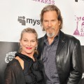 Jeff Bridges and his wife on the blue carpet at the 25th Film Independent Spirit Awards