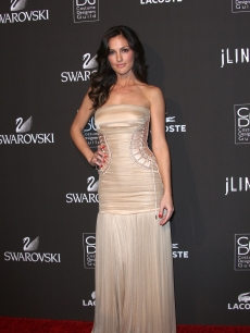 Minka Kelly arrives at the 12th Annual Costume Designers Guild Awards at The Beverly Hilton Hotel, Beverly Hills, February 25, 2010