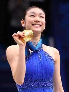 Kim Yu-Na of South Korea celebrates winning the gold medal in the Ladies Free Skating during the medal ceremony on day 14 of the 2010 Vancouver Winter Olympics at Pacific Coliseum on February 25, 2010