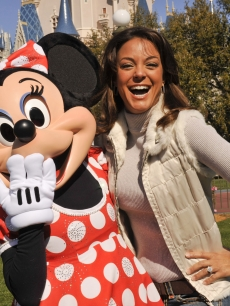 'CSI: Miami' star Eva La Rue  poses with Minnie Mouse at the Magic Kingdom, Lake Buena Vista, Florida, March 1, 2010