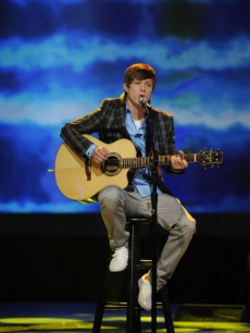 "Alex Lambert performs during top ten guys week on ""American Idol"""