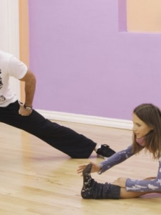 Aiden Turner and Edyta Sliwinska stretch out at a rehearsal for 'Dancing with the Stars' Season 10