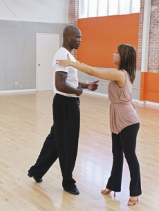 Chad Ochocinco listens to Cheryl Burke  during their &#8216;Dancing with the Stars&#8217; Season 10 rehearsals