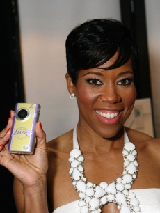 Regina King shows off her new Flip Video MinoHD Camcorder backstage at the 25th Film Independent Spirit Awards