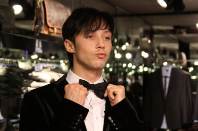 Johnny Weir fixes his bow tie with Access Hollywood in LA on March 4, 2010