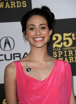 Emmy Rossum shows her smile on the blue carpet at the 25th Film Independent Spirit Awards in LA on March 5, 2010