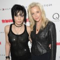 Joan Jett and Cherie Currie of the rock group The Runaways attend the premiere of 'The Runaways' at the Landmark Sunshine Cinema in New York City on March 17, 2010