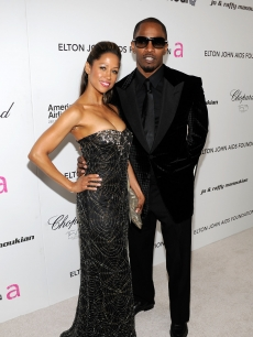 Stacey Dash and Jamie Foxx pose for the photogs before heading into 18th Annual Elton John AIDS Foundation Academy Awards party, Los Angeles, March, 7, 2010