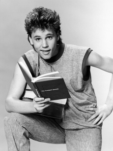 Corey Haim in character as a college student in a promotional portrait for the television series 'Roomies,' 1986
