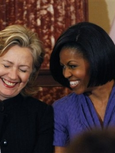 First Lady Michelle Obama and Secretary of State Hillary Clinton share a laugh as they present the 2010 International Women of Courage Awards at the State Department in Washington, D.C. on March 10, 2010