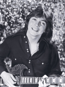 David Cassidy holds his guitar, 1970