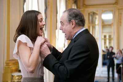 Marion Cotillard reacts as Culture Minister Frederic Mitterrand awards her Officer of the Order of Arts and Letters, on March 15, 2010 in Paris, France