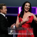 Access&#8217; Billy Bush helps Katherine Heigl as she accepts the Female Star of the Year Award after part of her dress broke during the ShoWest awards ceremony at the Paris Las Vegas during ShoWest in Las Vegas, Nevada on March 18, 2010 