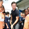 Tobey Maguire gets to work at the launch of 'Teaching Garden' in Inglewood, California on March 22, 2010