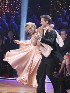 Former 'Bachelor' star Jake Pavelka and partner Chelsie Hightower romance the crowd with a Viennese Waltz to Seal's 'Kiss from a Rose' during the Season 10 premiere of 'Dancing with the Stars' on March 22, 2010