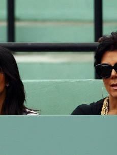 Kim Kardashian and her mother Kris Jenner look stylish in their shades as they watch the 2010 Sony Ericsson Open at Crandon Park Tennis Center in Key Biscayne, Fla. on March 29, 2010