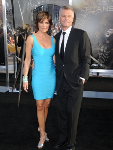 Lisa Rinna and Harry Hamlin arrive to the premiere of Warner Bros. 'Clash Of The Titans' held at Grauman's Chinese Theatre on March 31, 2010 in Los Angeles, California.