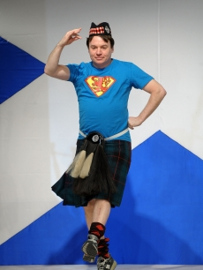 Mike Myers dances his way down the runway at the 8th annual 'Dressed To Kilt' Charity Fashion Show presented by Glenfiddich at M2 Ultra Lounge in New York City on April 5, 2010