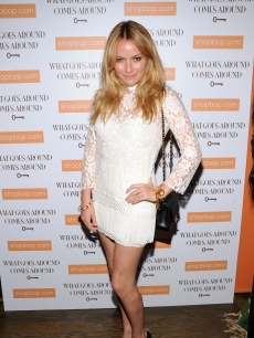 Becki Newton attends the debut of a vintage Chanel accessories collection at What Goes Around Comes Around, NYC, April 21, 2010