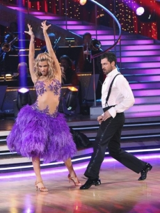 Erin Andrews ruffles her feathers to the samba with partner Maksim Cherkovskiy on 'Dancing with the Stars' Season 10, Week 6 on April 26, 2010