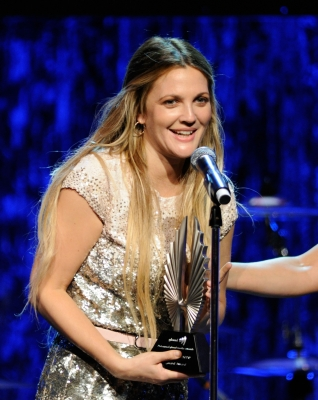 Drew Barrymore accepts the 2010 Vanguard Award onstage at the 21st Annual GLAAD Media Awards held at Hyatt Regency Century Plaza Hotel in Los Angeles, California on April 17, 2010
