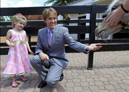 Larry Birkhead and daughter Dannielynn feed a pony at the Kentucky Derby Museum in Louisville, Ky. on April 28, 2010