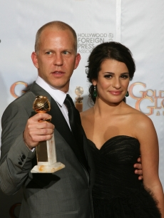 Ryan Murphy poses with Lea Michele and his trophy for Best Television Series-Comedy or Musical for 'Glee' in the photo room at the 67th Annual Golden Globe Awards at the Beverly Hilton Hotel in Beverly Hills, California, January 17, 2010