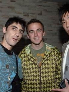 Frankie Muniz poses with friends at the Hollywood hot spot