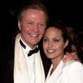 Jon Voight and daughter Angelina Jolie cuddle up at the Vanity Fair Oscar Party, March 25, 2010