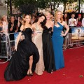 Sarah Jessica Parker, Kristin Davis, Kim Cattrall and Cynthia Nixon stand arm in arm at the UK premiere of 'Sex and The City 2' at Odeon Leicester Square in London on May 27, 2010