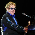 Elton John smiles from the stage at the Rock in Rio Festival in Lisbon, Portugal, on May 22, 2010