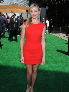 Cameron Diaz brings red to the green carpet at the premiere of &#8216;Shrek Forever After&#8217; in LA on May 16, 2010