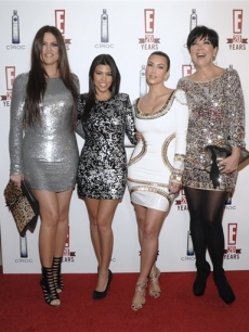 Khloe Kardashian, Kourtney Kardashian, Kim Kardashian and Kris Jenner show family love at the 20th birthday party for E! Entertainment Television in West Hollywood, Calif. on May 24, 2010