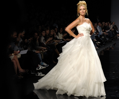 Mischa Barton shows off a creation from Rosa Clara's latest bridal collection in Barcelona, Spain, May 18, 2010