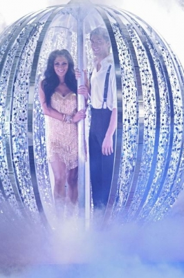 Nicole Scherzinger and Evan Lysacek descend in a giant mirror ball during the 'Dancing with the Stars' Season 10 finale on May 25, 2010